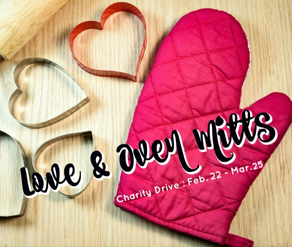 Cookie cutters,heart shape on the wooden background